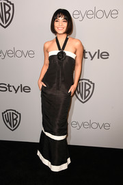 Vanessa Hudgens was summer-glam in a black-and-white halter gown by Chanel at the Warner Bros. and InStyle Golden Globes after-party.