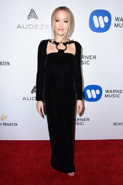 Rita Ora donned an edgy-glam chain-accented velvet gown by Tom Ford for the Warner Music Group Grammy party.