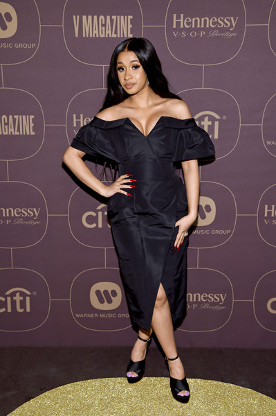 Cardi B styled her dress with black cross-strap platforms by Sophia Webster.