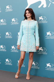 Penelope Cruz polished off her look with silver ankle-strap sandals.