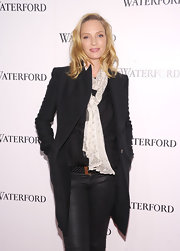 Uma Thurman made a case for simplicity in a classic black wool coat with clean sharp lines.