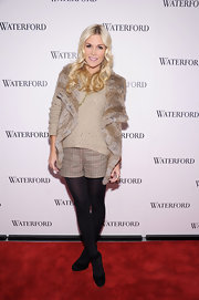 Tinsley Mortimer made her beige plaid short winter appropriate with the addition of a cozy cable sweater and opaque tights.