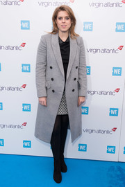 Princess Beatrice teamed black ankle boots with a double-breasted gray coat for WE Day UK.