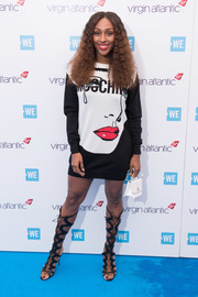 Alexandra Burke sported a cute face-and-logo-print sweater dress by Moschino at WE Day UK.