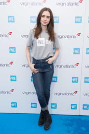 Lily Collins paired her shirt with blue skinny jeans.