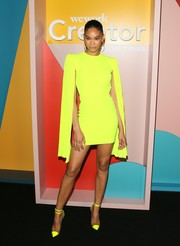 Chanel Iman stood out in a neon-yellow cape-sleeve mini dress by Alex Perry at the WeWork Creator Awards Global Finals.