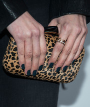 Debby Ryan accessorized her black outfit with an animal-print clutch by Vince Camuto during the Who What Wear event.