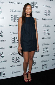 Ashley Madekwe opted for a navy mini skirt and a matching sleeveless top for the Who What Wear event.