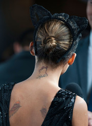 Nicole Richie styled her hair in a twisted bun, complete with a cat-ear headband, for the Who What Wear event.