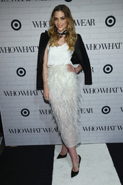 Jaime King arrived for the Who What Wear x Target launch party wearing a cropped tux jacket and a white feather skirt.
