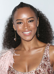 Serayah McNeill styled her hair into a half-up curly 'do with a braided top for the Wearable Art Gala.