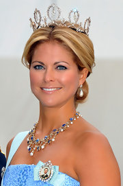 Princess Madeleine sported an elegant loose bun while wearing her decadent crown.