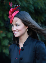 Pippa Middleton wore gold dangle earrings with gemstones.