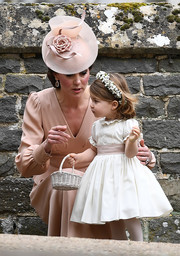 Kate Middleton paired a rose-accented Jane Taylor fascinator with a beige dress for her sister Pippa's wedding.