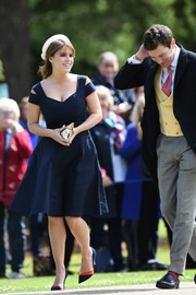 Princess Eugenie styled her frock with a pair of color-block pumps by Zara.