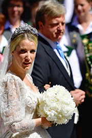 Ekaterina Malysheva accessorized with a bejeweled tiara for her wedding to Prince Ernst August of Hanover.