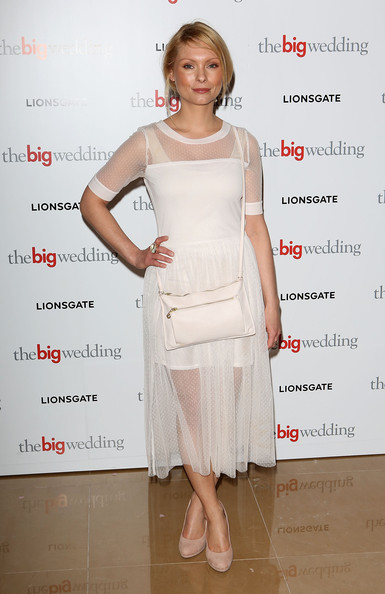 Myanna Buring showed just a touch of skin with this white netted flowing dress!
