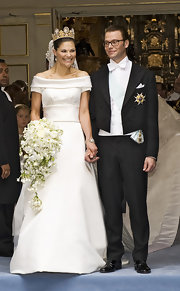 Princess Victoria chose a simple but absolutely elegant off-the-shoulder gown that featured a long embroidered train for her wedding.