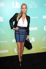 Kristin Chenoweth got an edge from her Madame Butterfly booties. She paired the bow adorned cutout boots with a leather jacket and bandage skirt.