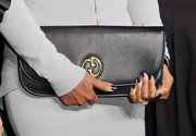 The first lady of Hip Hop and soul showed off her classic leather flap clutch while hitting a New York red carpet.