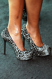 Mary J. Blige paired her stylish look with leopard print hidden platform pumps.