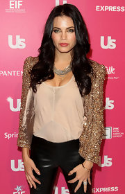 Jenna looks fantastic in an open front sequins jacket over leather pants.