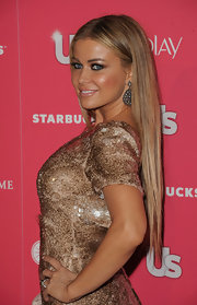Carmen Electra styled her sleek locks in a center part hairstyle for the 'Us Weekly' Hot Hollywood party.