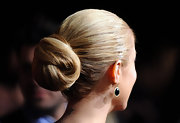 Kristin's sleek knotted updo is delicate and sophisticated style. This is a gorgeous evening look.