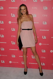Petra Nemcova teamed her girlish pink frock with black bow-adorned pumps.