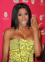 Ciara off-set her bright yellow Versace dress with hot pink nail polish.
