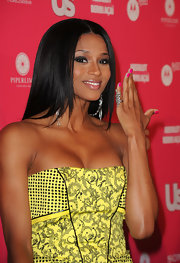 Ciara topped off her vibrant Versace dress with a silver snake ring that was coiled around her finer.