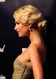 Paris Hilton wore her hair in slightly mussed Marcel waves and wrapped into a low bun at the 2012 Golden Globe Awards After Party.