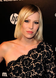 Natasha Bedingfield added a punch of color to her black ensemble at the Weinstein Company's 2012 Golden Globe Awards after party by sweeping on a creamy coral lipstick