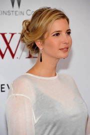 Ivanka Trump attended the NYC premiere of 'W.E.' wearing her hair in a casually tousled updo.
