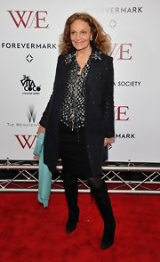 Iconic designer DVF opted for black suede boots at the 'W.E.' premiere.