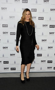 Alicia Silverstone glammed up a silmple black sheath with satin platform pumps.