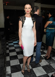 Juliette Lewis perfectly paired strappy black Jimmy Choo sandals with her lovely dress.