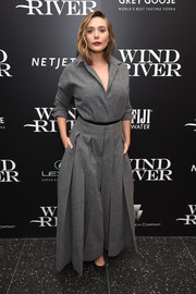 Elizabeth Olsen looked sharp in a gray wide-leg jumpsuit by Christian Dior Couture at the screening of 'Wind River.'