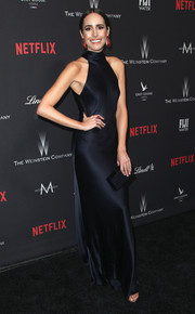Louise Roe showed off her slim physique in a slinky black halter gown at the Weinstein Company Golden Globes party.
