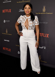 Toni Braxton proved she still has it when she wore this white Gregorio Sanchez jumpsuit, boasting a see-through bodice with a gaping keyhole cutout, at the Weinstein Company and Netflix Golden Globe party.