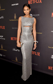 Chanel Iman wowed at the Weinstein Company and Netflix Golden Globe party in a Kaufmanfranco slashed dress that looked like liquid silver poured on her svelte body!