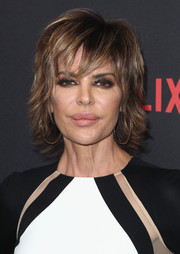 Lisa Rinna worked a layered razor cut at the Netflix Golden Globe party.