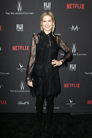 Kelly Rutherford paired her LBD with a black envelope clutch.