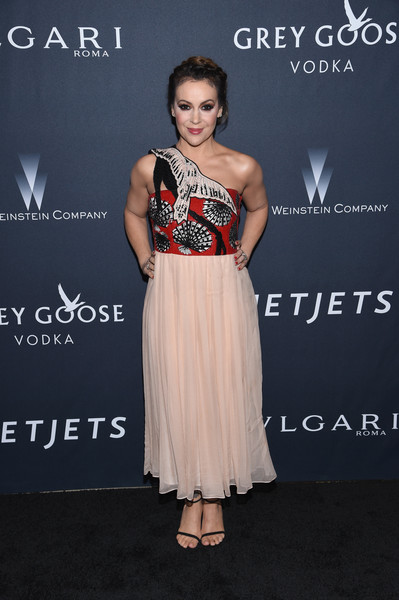 Alyssa Milano opted for a bird-motif one-shoulder dress when she attended the Weinstein Company pre-Oscar dinner.