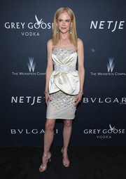 Nicole Kidman complemented her dazzling dress with a pair of silver ankle-strap sandals.
