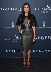 Rachel Roy added a dose of sex appeal with a metallic pencil skirt.