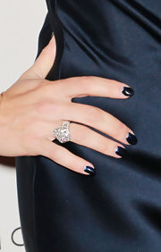 Kelly Brook to the moon manicure to the next level with a deep navy polish. Kudos!