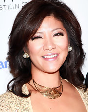 Julie Chen added some bling to her neckline with a gold decorative necklace complete with unique designs.