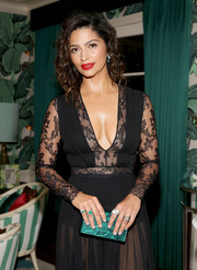 Camila Alves matched her green clutch with a pair of emerald rings for a Weinstein Company party.