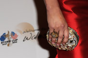 Catherine paired her ravishing red dress with a sparkling hard case clutch.